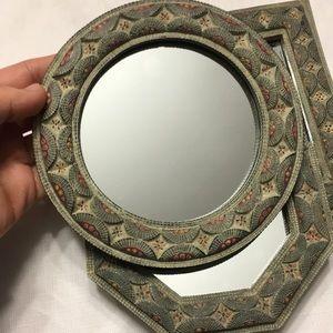 Three small mirrors